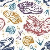 Fossil seamless pattern with dinosaur bones. Royalty Free Stock Photography