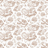 Fossil seamless pattern with dinosaur bones. Stock Image