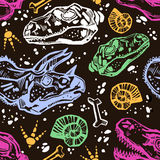 Fossil seamless pattern with dinosaur bones. Royalty Free Stock Image