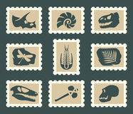 Fossiles set. Prehistoric fossiles on postage stamps Stock Image