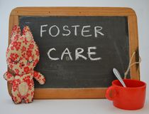 Foster Care. A blackboard with written text foster care Royalty Free Stock Images