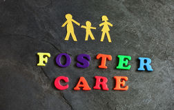 Foster Care Family. Paper family of three with Foster Care letters Stock Photos