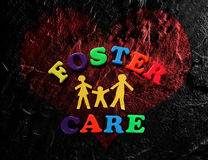 Foster Care heart. Paper family with Foster Care letters and red heart Royalty Free Stock Images