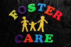 Foster Care. Paper cutout family with Foster Care letters Stock Images