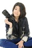 Fotógrafo adolescente de reclinación Foto de archivo