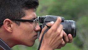 Fotógrafo adolescente de sexo masculino de la afición Imágenes de archivo libres de regalías