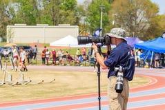 Fotógrafo Captures Track Invitational imagem de stock royalty free