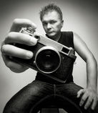 Fotógrafo con la cámara Fotografía de archivo libre de regalías