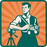 Fotógrafo con la cámara de DSLR y vídeo retro Imagen de archivo