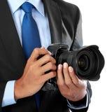 Fotógrafo con la cámara del dslr Imágenes de archivo libres de regalías