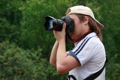 Fotógrafo con la cámara a disposición Foto de archivo