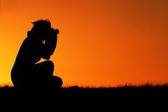 Fotógrafo da fêmea da silhueta Fotografia de Stock