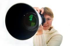 Fotógrafo da mulher com a lente objetiva grande imagens de stock