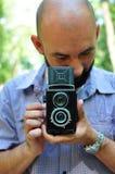 Fotógrafo de la cámara del vintage fotos de archivo