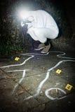 Fotógrafo de la escena del crimen Imagen de archivo libre de regalías
