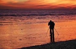 Fotógrafo de la puesta del sol Foto de archivo libre de regalías