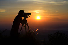 Fotógrafo de la puesta del sol Fotos de archivo