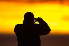 Fotógrafo de la salida del sol Fotos de archivo