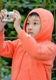 fotógrafo de los niños Foto de archivo libre de regalías