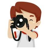 Fotógrafo de sexo femenino que sostiene una cámara digital