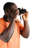 Fotógrafo del estudiante que toma un cuadro con la cámara Foto de archivo libre de regalías