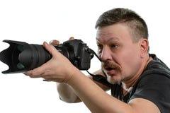 Fotógrafo del retrato con una cámara en un fondo aislado Foto de archivo libre de regalías