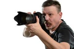 Fotógrafo del retrato con una cámara en un fondo aislado Fotos de archivo