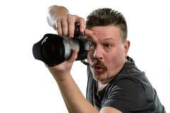 Fotógrafo del retrato con una cámara en un fondo aislado Foto de archivo
