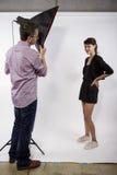 Fotógrafo Demonstrating Studio Photography foto de archivo libre de regalías