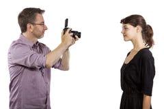 Fotógrafo Demonstrating Studio Photography Imagen de archivo libre de regalías