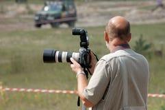 Fotógrafo detrás del trabajo Foto de archivo