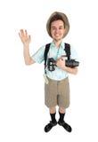 Fotógrafo divertido del hombre con la cámara y la mochila Foto de archivo libre de regalías