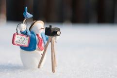 Fotógrafo do boneco de neve Imagem de Stock Royalty Free