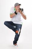 Fotógrafo do homem com a câmera no pose engraçado Fotografia de Stock