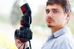 Fotógrafo do homem novo Fotografia de Stock Royalty Free