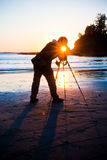 Fotógrafo do louro do por do sol Fotos de Stock Royalty Free