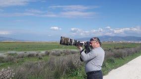 Fotógrafo do pássaro fotos de stock
