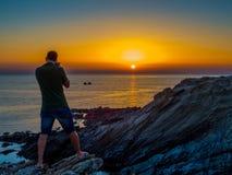 Fotógrafo do por do sol Imagens de Stock Royalty Free