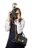 Fotógrafo do repórter da menina com câmera retro e flash Fotos de Stock Royalty Free