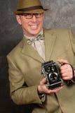 Fotógrafo dos paparazzi com câmera do vintage Foto de Stock
