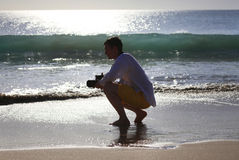 Fotógrafo em uma praia foto de stock