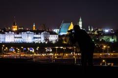 Fotógrafo en el tejado en Varsovia Imagen de archivo libre de regalías