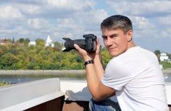 Fotógrafo en el tiroteo de la foto Imagen de archivo