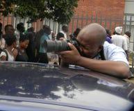 Fotógrafo en el trabajo durante el demostration de anti-Mugabe fotografía de archivo libre de regalías