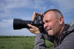 Fotógrafo en la acción Imágenes de archivo libres de regalías