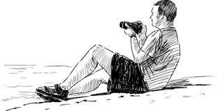 Fotógrafo en la playa Imagenes de archivo