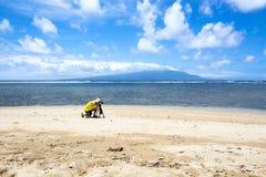 Fotógrafo en la playa Fotos de archivo libres de regalías