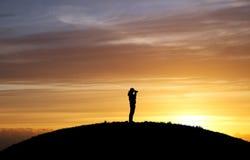 Fotógrafo en puesta del sol imágenes de archivo libres de regalías
