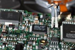 Fotógrafo en tarjeta de circuitos impresos Fotografía de archivo libre de regalías