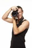 Fotógrafo joven con la cámara Imagenes de archivo